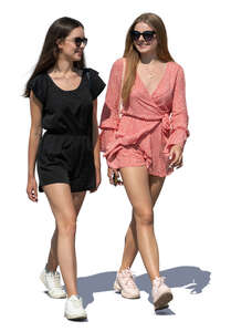 two smiling young women walking