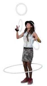 female street artist with a hoop and joggling