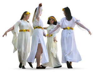four women in white robes dancing