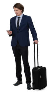young businessman with a suitcase standing