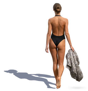 woman in a black bathing suit walking