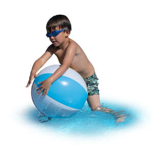 little boy playing with a beach ball in the water