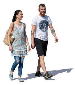 smiling man and woman walking on a sunny day