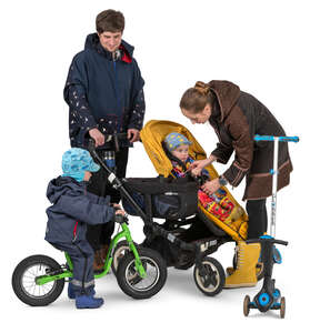 family with two kids and a stroller standing