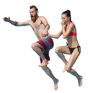 man and woman jumping into pool together