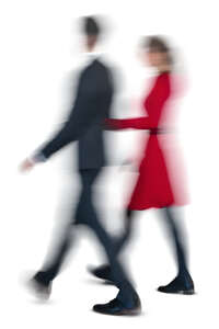 motion blur image of a man and woman walking