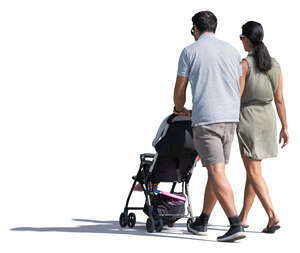 couple with a baby stroller walking