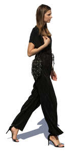 woman in a black jumpsuit walking