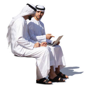 two emirati men sitting and talking