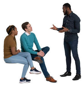 group of three adults sitting and talking