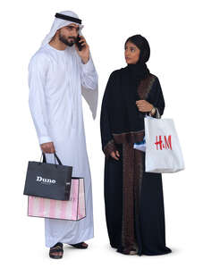 arab man and woman with shopping bags standing