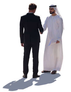 businessman shaking hans with an arab man