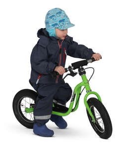 little boy riding his bike