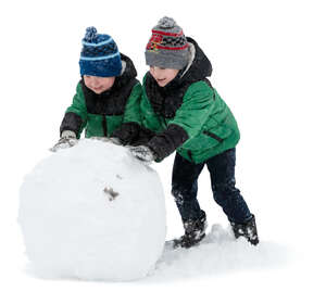 two boys building a large snowball