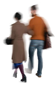 motion blur image of a couple walking arm in arm