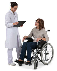 doctor talking to an older woman in a wheelchair