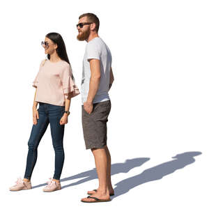 man and woman standing and looking in one direction