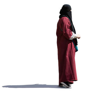 muslim woman with a niqab standing