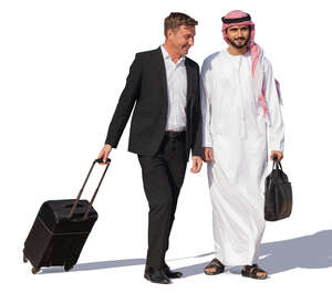 businessman and emirati man with suitcases walking