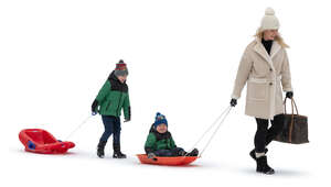 mother with two sons going sledging