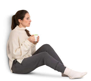 woman with a coffee mug sitting by the window