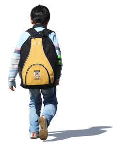 little boy with aschoolbag walking