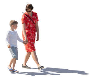 backlit image of a a mother and son walking