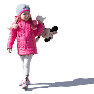 little girl with toy Minnie Mouse walking