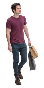 young man with shopping bags walking