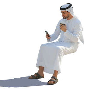 arab man sitting and drinking coffee