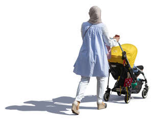 muslim woman with a baby stroller walking