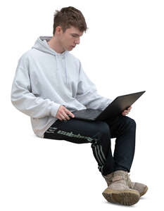 young man with a laptop sitting on a bench