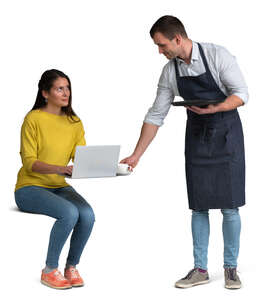 waiter bringing coffee to a woman sitting at a table