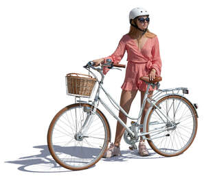 woman with a helment standing by a bicycle