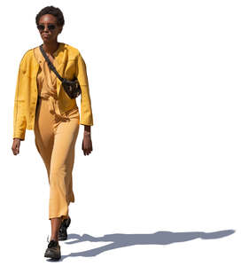 woman in a yellow costume walking
