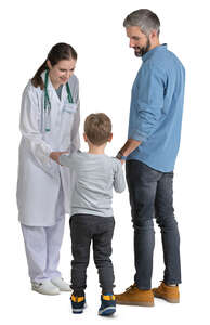 female doctor talking to a man with a child