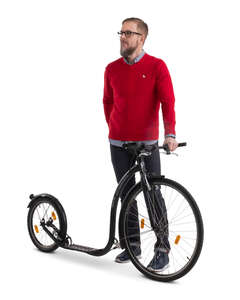 man with a kickbike standing