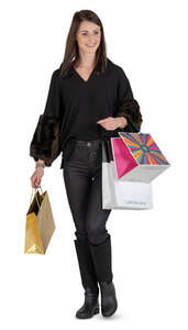 happy woman with shopping bags walking
