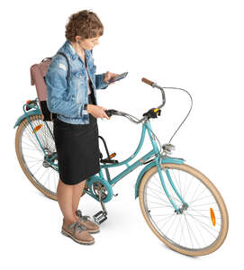 woman with a bicycle stopping and checking her phone