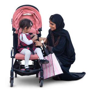 muslim woman squatting by the baby stroller