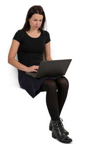 woman sitting with a laptop on her knees