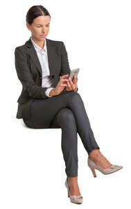 businesswoman sitting and texting
