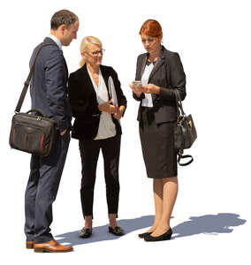 group of three business people standing outside