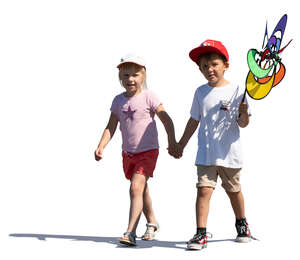 two kids walking hand in hand