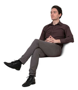 man sitting and looking into distance