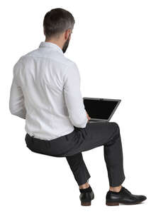 businessman sitting with a laptop on his knees