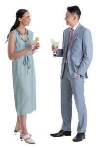 two people standing and drinking cocktails