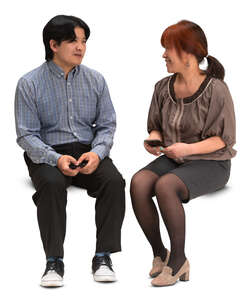 asian man and woman sitting and talking