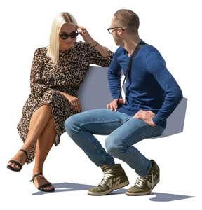 man and woman sitting on a bench and talking