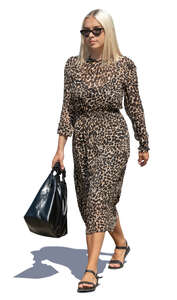 woman in a leopard print dress walking